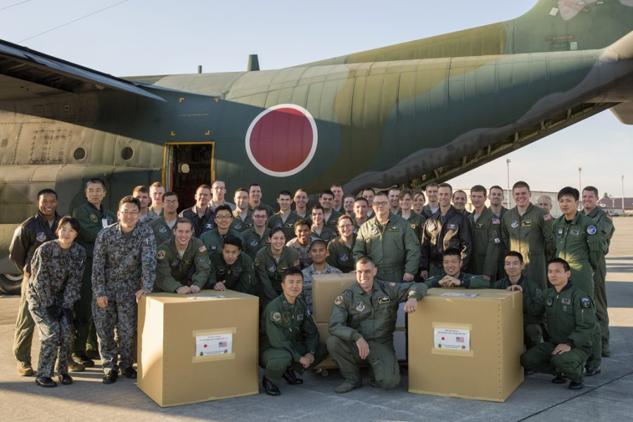 %22JASDF+and+USAF+Airmen+deliver+Operation+Christmas+Drop+donations%22+by+%23PACOM+is+licensed+under+CC+BY-NC-ND+2.0