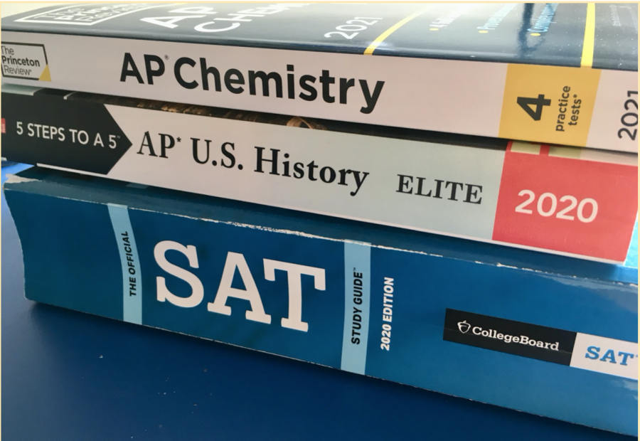 A sample of 3 AP and SAT prep books - which combined, cost almost $80 - acts as a symbol for the high cost of succeeding in both standardized tests and college admissions.