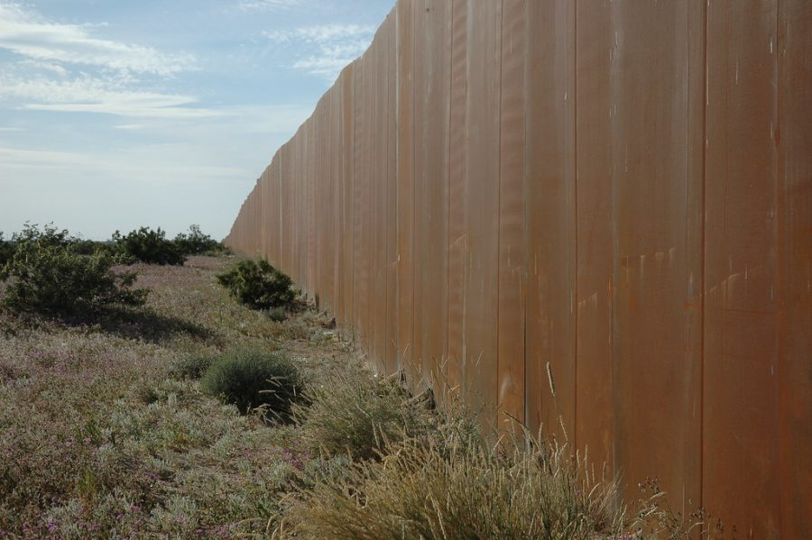 %22The+Wall%2C+US+border%2C+separating+Mexico+from+the+US%2C+along+Highway+2%2C+Sonora+Desert%2C+Mexican+side%22+by+Wonderlane+is+licensed+under+CC+BY+2.0