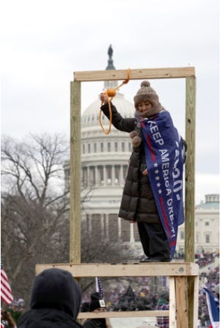 Some rioters had zip ties, kevlar vests, and they put up a wooden gallows by the Capitol Reflecting Pool.   Image Credit: USA Today, Trevor Hughes