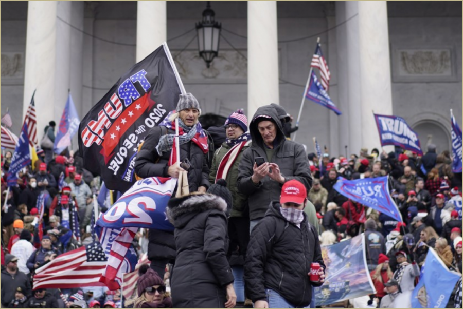 The abundance of Trump flags clearly shows how the rioters at the Capitol idolized Trump more than they valued democracy and truth. Source: Kent Nishimura / Los Angeles Times)